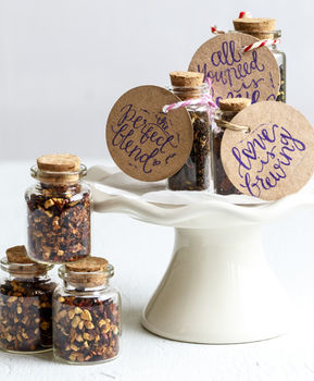 37 unusual personalised wedding favour ideas real wedding cute wedding favour tea in glass bottle with cork junglespirit Gallery